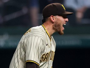 Padres starter Joe Musgrove reacts after pitching a no-hitter against the Rangers at Globe Life Field in Arlington, Texas, Friday, April 9, 2021. This is the first no-hitter in franchise history for the Padres.