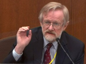 Chicago-based breathing expert Dr. Martin Tobin answers questions during the ninth day of the trial of former Minneapolis police officer Derek Chauvin for second-degree murder, third-degree murder and second-degree manslaughter in the death of George Floyd in Minneapolis, Minn., April 8, 2021 in a still image from video.