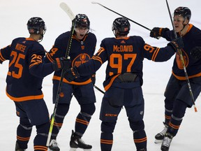 Edmonton Oilers Ethan Bear (74) celebrates his goal with teammates against the Montreal Canadiens during third period NHL action on Monday, April 19, 2021 in Edmonton.