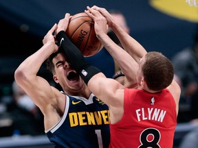 Denver Nuggets forward Michael Porter Jr. (1) is fouled while driving to the net against Toronto Raptors guard Malachi Flynn at Ball Arena on April 29, 2021.