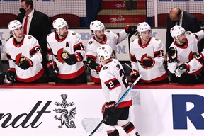 Ottawa Senators defenceman Artem Zub is congratulated by his teammates after scoring against the Montreal Canadiens on Saturday night.