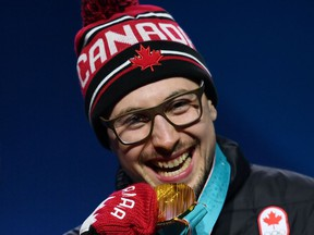 London's Alexander Kopacz poses on the podium after winning gold at the 2018 Winter Olympics. (AFP)