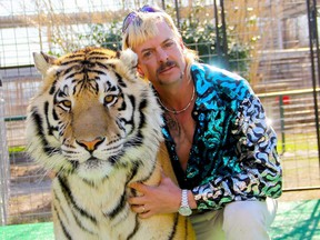 "This undated file photo courtesy of Netflix shows Joseph ""Joe Exotic"" Maldonado-Passage with one of his tigers."
