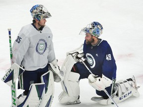 The outstanding play of Braden Holtby (right) in net for the Canucks this week makes the return of Thatcher Demko (left) to the crease less essential, but still inevitable.