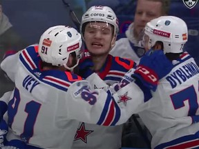 Vasily Podkolzin is mobbed by his SKA St. Petersburg teammates after scoring the winner in the third overtime period of Game 5 against CSKA Moscow in the KHL playoffs on Saturday.