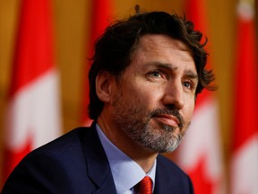 Prime Minister Justin Trudeau looks on during a news conference in Ottawa, March 30, 2021.