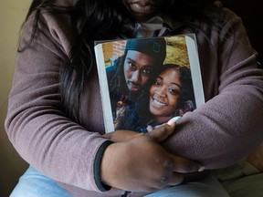 Lashonnah Nix, sister of Lymond Moses, who was shot and killed by police, poses for a portrait with a photo she embraces daily in Wilmington, Delaware, U.S., April 23, 2021. Picture taken April 23, 2021.