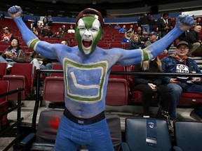 A fan cheers before the NHL game between the Vancouver Canucks and the Edmonton Oilers at Rogers Arena on January 16, 2019.