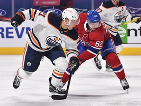 Dominik Kahun (21) of the Edmonton Oilers skates against Artturi Lehkonen (62) of the Montreal Canadiens at Bell Centre on May 12, 2021, in Montreal.