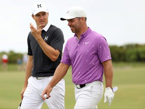 (L-R) Jordan Spieth of the United States walks with Paul Casey of England during a practice round prior to the 2021 PGA Championship at Kiawah Island Resort's Ocean Course on Wednesday.