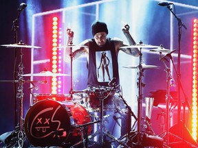 Musician Travis Barker performs onstage during the 2016 American Music Awards at Microsoft Theater on November 20, 2016 in Los Angeles, California.