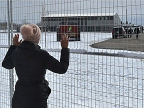 A women chanting as a crowd of about 400 gathered outside GraceLife Church on the first Sunday after the closure west of the Edmonton city limits, April 11, 2021. Ed Kaiser/Postmedia