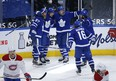 Maple Leafs' Auston Matthews celebrates his 40th goal of the season with teammates during the third period against the Canadiens in Toronto on Thursday, May 6, 2021.
