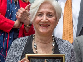 In this file photo taken on May 24, 2013, actress Olympia Dukakis is honoured with the 2,498th Star on the Hollywood Walk of Fame in Hollywood, Calif.