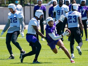 Vikings wide receiver Justin Jefferson (18) runs after the catch in drills at OTA at TCO Performance Center in Eagan, Minn., Wednesday, May 26, 2021.