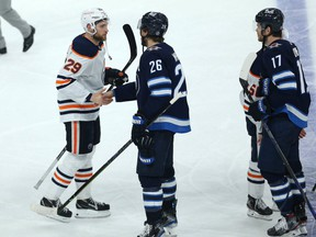 Winnipeg Jets captain Blake Wheeler (second from right) shakes hands with Edmonton Oilers forward Leon Draisaitl after the Jets swept the Oilers in a Stanley Cup playoff series in Winnipeg on Mon., May 24, 2021.