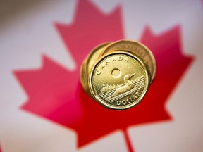 A Canadian dollar coin is pictured in this illustration taken in Toronto, Jan. 23, 2015.