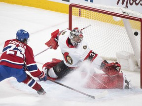 Cole Caufield scores on Ottawa Senators' goaltender Filip Gustavsson in overtime action at the Bell Centre on Saturday, May 1, 2021.
