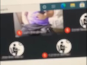 A screengrab from a clip of a virtual classroom session at St. Stephen Catholic Secondary School in Bowmanville shows a man with his hand down his pants.