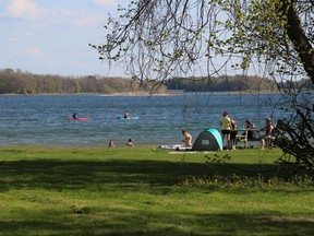 People enjoy the warm weather at Lakeview Waterfront Park in Lakeview Heights, Ont., May 14, 2021.