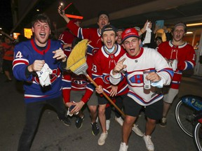 Montreal Canadiens fans had their brooms out outside the Bell Centre after the Canadiens' four-game sweep of the Winnipeg Jets following the NHL playoff game in Montreal June 7, 2021.