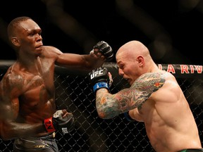 GLENDALE, ARIZONA - JUNE 12: Israel Adesanya of Nigeria throws a left on Marvin Vettori of Italy during their UFC 263 middleweight championship match at Gila River Arena on June 12, 2021 in Glendale, Arizona.