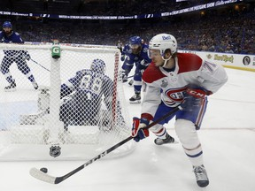 Jake Evans #71 of the Montreal Canadiens carries the puck against the Tampa Bay Lightning during the third period in Game 1 of the 2021 NHL Stanley Cup Final at Amalie Arena in Tampa, Florida.