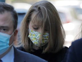 Actor Allison Mack, known for her role in the TV series 'Smallville', arrives with her lawyers to be sentenced for her part in NXIVM cult, at United States Federal Courthouse in Brooklyn, New York City, June 30, 2021.