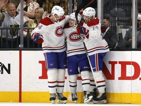 Canadiens forward Cole Caufield (centre) is congratulated by teammates Nick Suzuki (right) and Corey Perry after scoring a goal against the Golden Knights during the second period in Game 5 of the Stanley Cup Semifinals at T-Mobile Arena in Las Vegas, Tuesday, June 22, 2021.