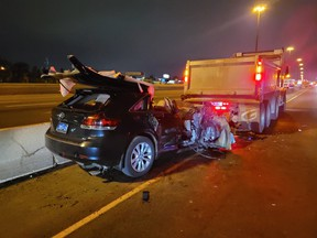 A vehicle is barely recognizable after it slammed into a stopped dump truck in a construction zone on Hwy. 401 near Dufferin St. early Tuesday, June 1., 2021.