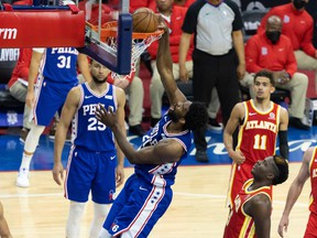 Philadelphia 76ers centre Joel Embiid dunks the ball in front of Atlanta Hawks centre Clint Capela during the second quarter in Game 2 of the second round of the 2021 NBA Playoffs at Wells Fargo Center in Philadelphia, June 8, 2021.