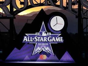 Logos for the 2021 MLB All-Star Game are on display during the fourth inning of the game between the Rockies and Reds at Coors Field in Denver, May 13, 2021.