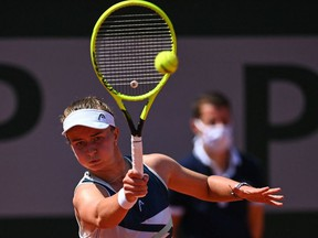 Czech Republic's Barbora Krejcikova returns the ball to Sloane Stephens of the US during their women's singles fourth round tennis match on Day 9 of The Roland Garros 2021 French Open tennis tournament in Paris on June 7, 2021.