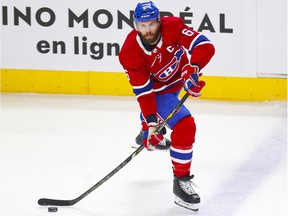 Montreal Canadiens captain Shea Weber carries the puck up during first period against the Calgary Flames in Montreal on April 14, 2021.