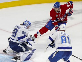 Tampa Bay Lightning's Andrei Vasilevskiy makes a save on shot by Montreal Canadiens' Corey Perry while defenceman Erik Cernak watches during first period of Game 4 in Montreal on July 5, 2021.