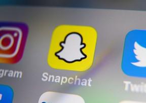 A picture taken on October 1, 2019 in Lille shows the logo of mobile app Snapchat displayed on a tablet.