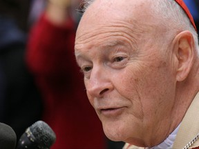 In this file photo taken on April 3, 2005, Cardinal Theodore McCarrick, Archbishop of Washington, speaks to reporters outside the Cathedral of Saint Matthew the Apostle in Washington, D.C.