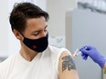 Prime Minister Justin Trudeau receives his second coronavirus vaccine at a pharmacy in Ottawa, July 2, 2021.
