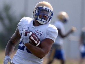Running back Brady Oliveira lugs the ball at Blue Bombers training camp on July 14, 2021.