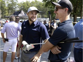 Montreal Canadiens winger Jonathan Drouin, left, and Laval Rocket centre Laurent Dauphin speak before the start of Canadiens head coach Dominique Ducharme's charity golf tournament in Joliette on Aug. 26, 2021.