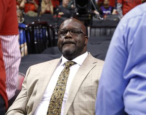 Shaq sits in the crowd during the second half of a Raptors game in Toronto on May 21, 2019.