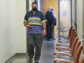 Co-accused Guy Dion walks through the hall during a break in his murder trial with Marie-Josée Viau at the Gouin courthouse in Montreal on May 31, 2021.
