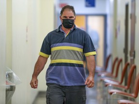 Co-accused Guy Dion walks through the hall during a break in his murder trial at the Gouin courthouse in Montreal on May 31, 2021.