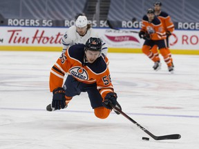 The Edmonton Oilers' Kailer Yamamoto (56) dives for a loose puck against the Toronto Maple Leafs at Rogers Place in Edmonton on Saturday, Feb. 27, 2021. The Leafs won 4-0.