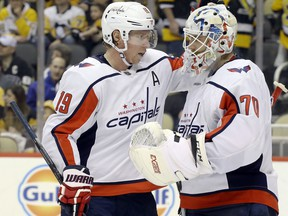 Washington Capitals centre Nicklas Backstrom, left, and goaltender Braden Holtby celebrate after defeating the Pittsburgh Penguins at PPG PAINTS Arena in Pittsburgh, May 7, 2020.
