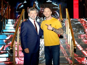 Andy Serkis and Tom Hardy attend the fan screening of Venom: Let There Be Carnage at Cineworld Leicester Square on Sept. 14, 2021 in London.