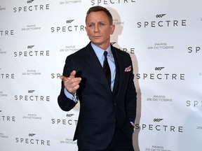 In this file photo taken on October 29, 2015, Daniel Craig poses during the French premiere of the new James Bond film 'Spectre' in Paris.