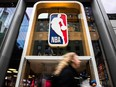 A pedestrian walks past the NBA store on 5th Avenue on March 12, 2020 in New York City.