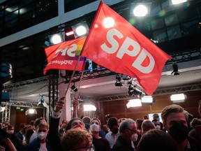 Social Democratic Party (SPD) supporters react after first exit polls for the general elections in Berlin, Germany, September 26, 2021.