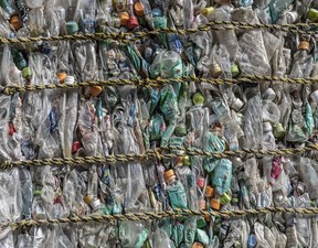 Plastic bottles are compressed into a bale at Asei plastic recycling company on November 5, 2020 in Kasama, Japan.
